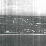 Aerial View of Runway from Aircraft About to Land, Passing Over the Beach